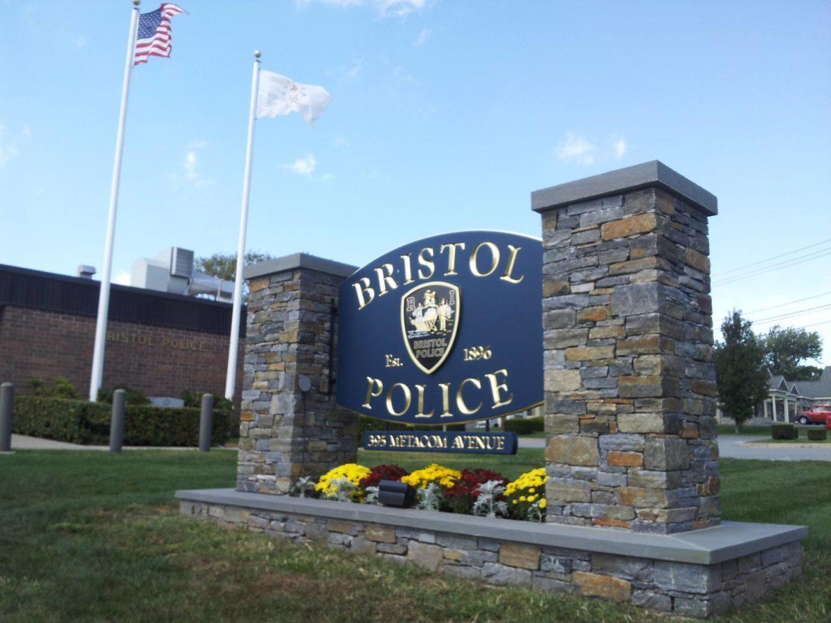 wood police department sign between 2 stone pillars